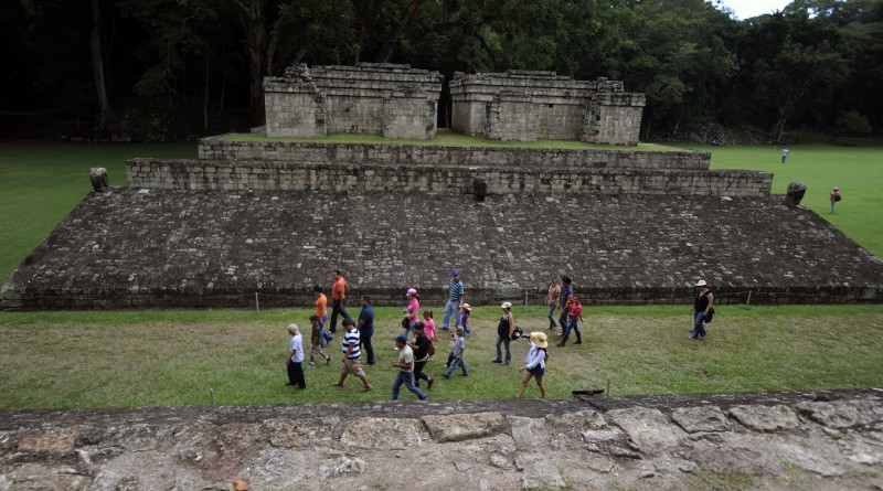 Tourists walk during a visit at the archaeological park in Copan, Honduras on August 20, 2012. Archaeologists believe that the collapse of ancient Copan´s society was so sudden, that the Mayas left unfinished buildings and abandonded tools.  AFP PHOTO/Orlando SIERRA